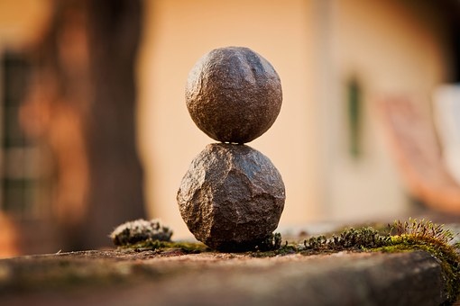 Two stones balanced on top of each other