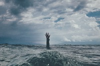Raised hand above water